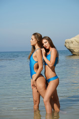Two lovely women in sea