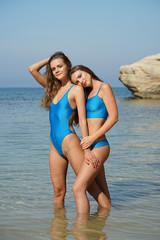 Two women in blue swimwear