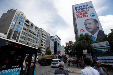 An election poster of Turkish President Tayyip Erdogan is seen in Istanbul