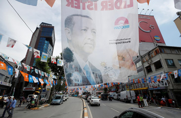 Banners of Turkish President Tayyip Erdogan hang over a street in Istanbul