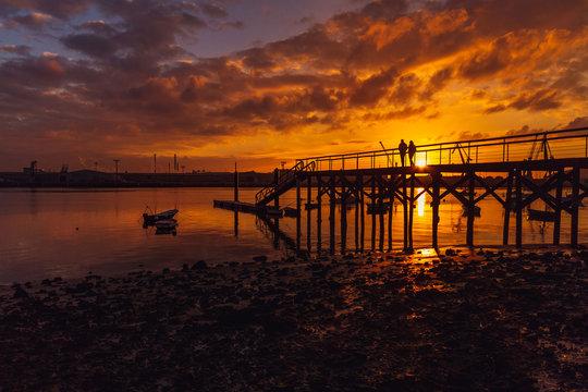 Pier on the beach of Zeluan in Gozon, Asturias