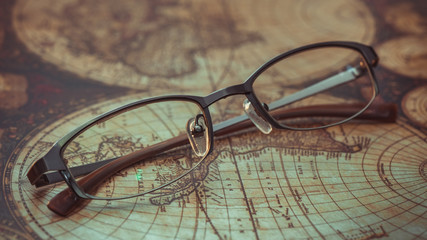 Eyeglasses On Old World Map