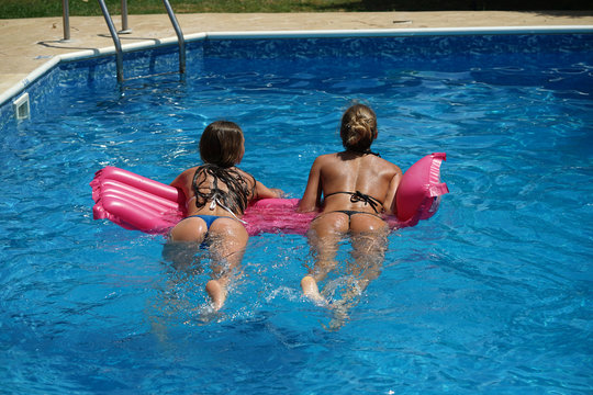 Two women floating on air mattress