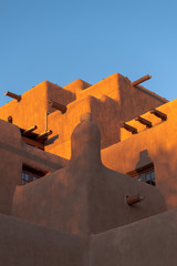 Adobe pueblo-style building glowing in the sunset in Santa Fe, New Mexico