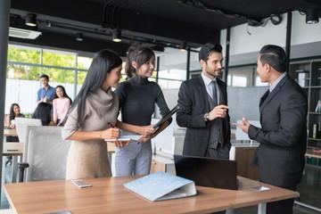 Businessmen were having discussing about their work. Business Corporation Organization Teamwork Concept. Setup studio shooting.