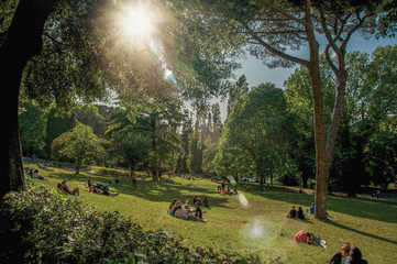 """View of people in park of the Villa Borghese on a sunny day in Rome, the incredible city of the Ancient Era, known as """"The Eternal City"""". Lazio region, central Italy"""