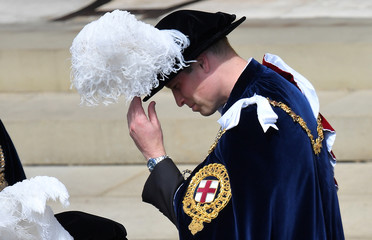 Britain's Prince William departs after attending the Order of the Garter ceremony and service at St. Georges's Chapel in Windsor, Britain