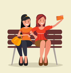 Two girls sit on a bench and take selfies.