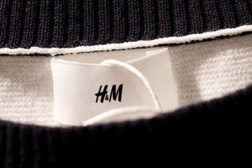 A Hennes & Mauritz AB (H&M) label is pictured on clothes at their flagship store in Paris