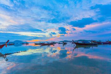 sweet sunrise above fishing boats in Rawai sea during high tide