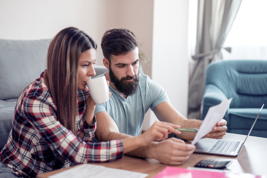 Young couple doing family finances at home