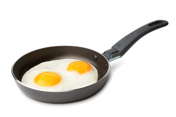 Fried eggs on griddle
