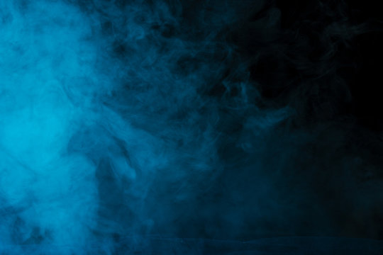mysterious and bright cloud of blue steam on a dark background
