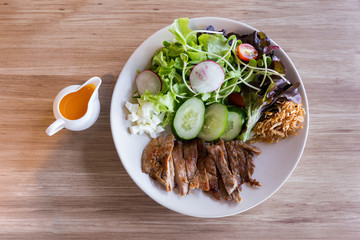 Luang Prabang Salad style with grilled pork served with yolk salad dressing.