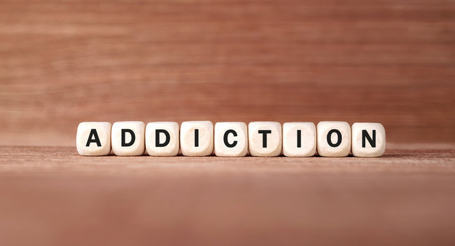 Word ADDICTION made with wood building blocks