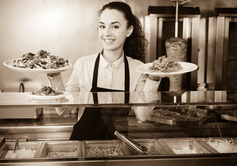 Ordinary brunette girl with kebab and vegetables