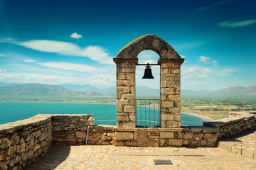 Panoramic landscape with old belfry at the top of Palamidi fortress in Nafplio, Peloponnese, Greece Wall mural