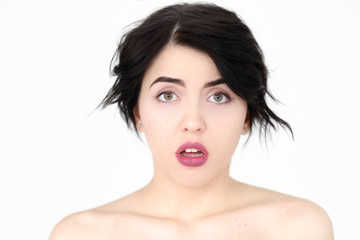 emotion face. overwhelmed perplexed shocked surprised astounded woman young beautiful brunette girl portrait on white background.