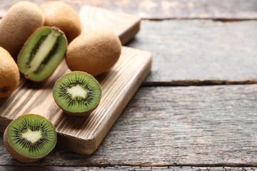 Kiwi fruits on brown cutting board