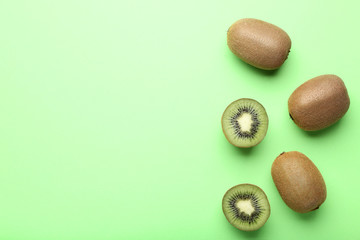 Kiwi fruits on green background