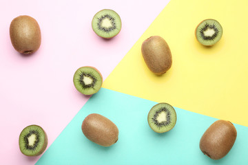 Sweet kiwi fruits on colorful background