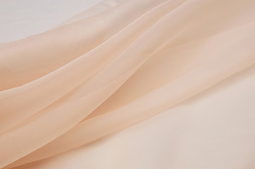 Silk fabric, organza is light beige.