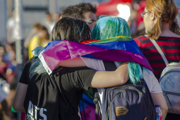 Girls with rainbow flag at an LGBT gay pride parade