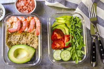 Healthy meal prep containers with quinoa and shrimp