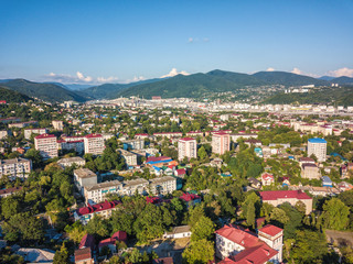 Aerial drone view on Tuapse town шт Russia, oil refinery and hills on horizone at day time in summer
