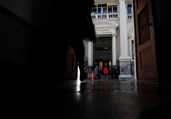 Pedestrians walk outside Argentina's Central Bank in Buenos Aires
