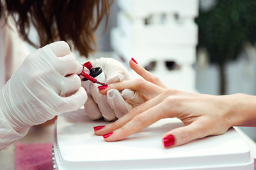 Printed kitchen splashbacks Manicure Young woman doing manicure in salon. Beauty concept.