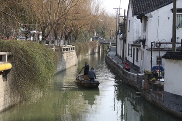 Beautiful Chinese city with canal bridge and tree