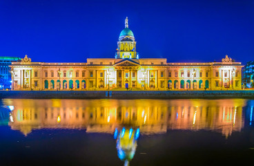 Night view of the Custom house situated next to the river lIffey in Dublin, Ireland
