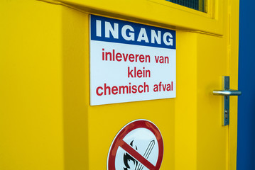 Entrance of a Dutch civic amenity with the text 'small chemical waste collection'