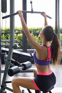 Woman doing exercise for her back - Lat pulldown