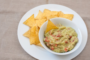 fresh mexican guacamole and tortilla chips
