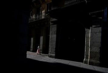 A woman walks in Madrid