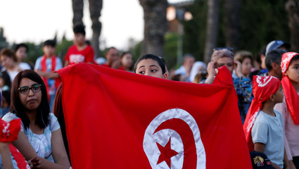 Fans react as they watch the broadcast of the FIFA World Cup Group G soccer match between Tunisia and England, in Tunis