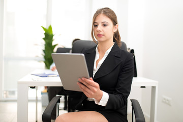 Woman using a tablet in her office