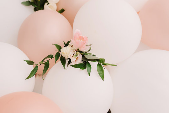 It is a lot of white and pink balloons. White-pink background