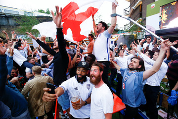 England soccer fans watch the team's first match in the World Cup against Tunisia at Flat Iron Square in London