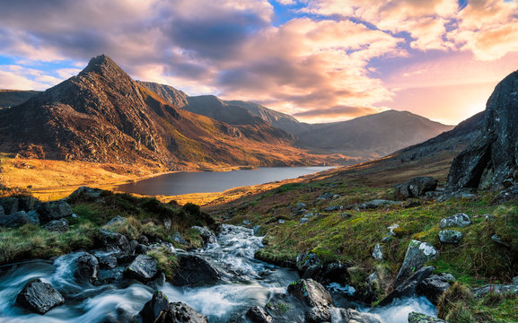 A rushing river flowing through the mountains of wales