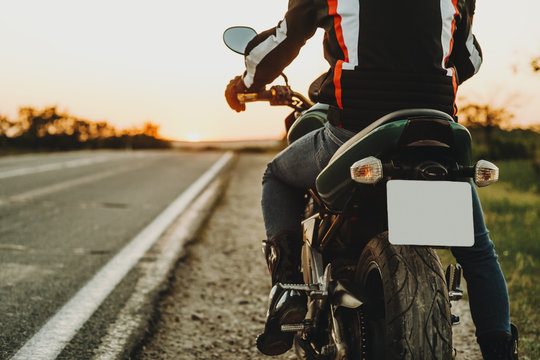 Man starting riding on motorcycle from roadside