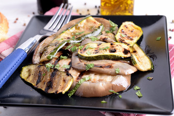 Eggplant and grilled and flavored sliced courgette
