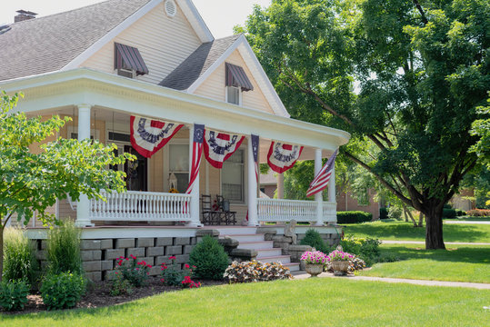 Charming home decorated with American flags for the Fourth of July