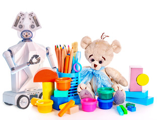 Robot toy and stuffed animals teddy bear and color pencils and cans of paint. White plastic device for children on isolated.