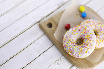 Donut on a wooden white background