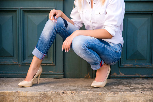 Woman wearing jeans and high heels