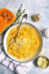 Delicious pumpkin risotto with garlic and thyme.Top view.