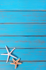 Starfish old weathered blue beach wood deck background vertical